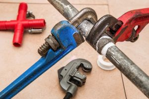 Plumber using tools