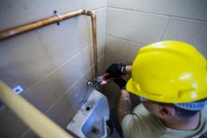 Plumber fixing Pipe